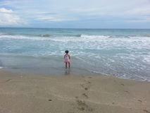 Little Girl Contemplating the Sea Stock Photography