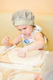 Little girl continue cooking pizza Royalty Free Stock Images