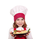 Little girl cook. Eat spaghetti Royalty Free Stock Images