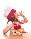 Little girl cook with apple cakes Royalty Free Stock Image