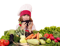 Little girl cook with aubergine Stock Images