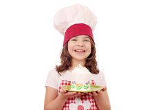 Little girl cook with big cupcake Royalty Free Stock Photography