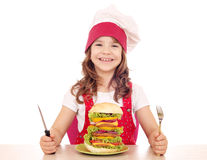 Little girl cook with big hamburger Royalty Free Stock Image