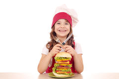 Little girl cook with big hamburger Royalty Free Stock Photos