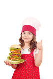 Little girl cook with big hamburger and thumb up Royalty Free Stock Photography