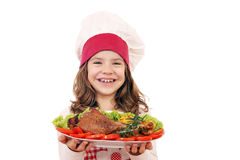 Little girl cook with big turkey drumstick Stock Photo
