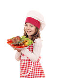 Little girl cook with big turkey drumstick Royalty Free Stock Photography