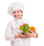 Little girl-cook with bowl of vegetables on shoulder Royalty Free Stock Photos