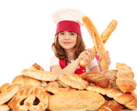 Little girl cook with bread buns and pretzels Royalty Free Stock Image