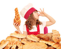 Little girl cook with bread and ok sign Royalty Free Stock Images