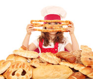 Little girl cook with breads and buns Royalty Free Stock Image