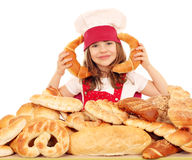 Little girl cook with breads and rolls Royalty Free Stock Photography