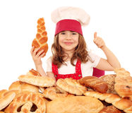 Little girl cook with breads rolls and thumb up Royalty Free Stock Image