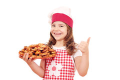 Little girl cook with bruschette and thumb up Royalty Free Stock Image