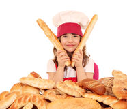 Little girl cook with buns and pretzel Stock Photos