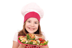 Little girl cook with burritos fast food Stock Photo