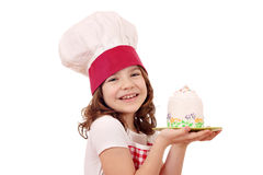 Little girl cook with cake portrait Royalty Free Stock Images