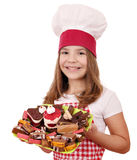 Little girl cook with cakes dessert Stock Photography