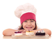 Little girl cook with cakes Royalty Free Stock Image