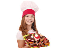 Little girl cook with cakes Stock Photography