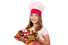 Little girl cook with cakes Royalty Free Stock Photos