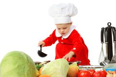 Little girl in a cook cap Royalty Free Stock Image