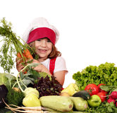 Little girl cook with carrots and vegetables Royalty Free Stock Images