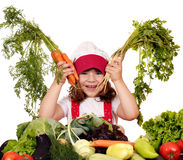 Little girl cook with carrots and vegetables Royalty Free Stock Photo