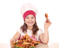 Little girl cook with chicken drumstick Royalty Free Stock Images