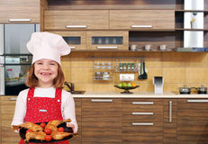 Little girl cook with chicken drumstick Royalty Free Stock Photos