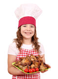 Little girl cook with chicken wings Royalty Free Stock Photography