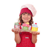 Little girl cook with colorful sweet cupcakes Royalty Free Stock Images