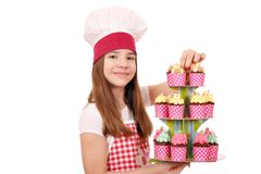 Little girl cook with colorful sweet muffins Stock Photo