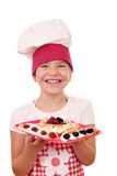 Little girl cook with crepes Royalty Free Stock Photos
