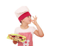 Little girl cook with crepes and ok hand sign Royalty Free Stock Photos