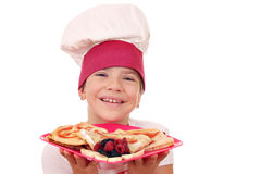 Little girl cook with crepes portrait Royalty Free Stock Photography