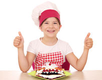 Little girl cook with crepes and thumbs up Royalty Free Stock Image