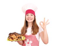 Little girl cook and croissant with chocolate on plate Royalty Free Stock Photos