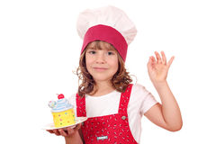 Little girl cook with cupcake Stock Image