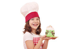 Little girl cook with cupcakes Stock Photos