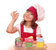 Little girl cook with cupcakes Royalty Free Stock Photography