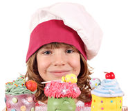 Little girl cook with cupcakes Stock Images