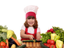 Little girl cook cutting cucumber Royalty Free Stock Images