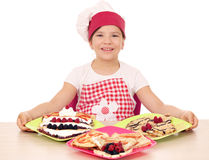 Little girl cook with delicious crepes on table Stock Image