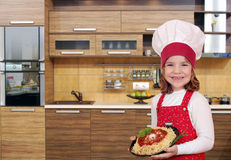 Little girl cook with delicious spaghetti in kitchen Stock Photo
