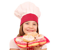 Little girl cook with donuts fast food Stock Image