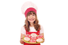 Little girl cook with donuts Stock Photo