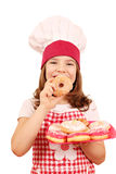 Little girl cook with donuts Royalty Free Stock Photos