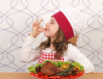 Little girl cook with drumstick Stock Photo