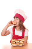 Little girl cook eat apple cake Stock Photos